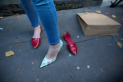 © licensed to London News Pictures. London, UK 22/11/2013. Marisa Hoy, the new owner of a pair of shoes which was donated by Victoria Beckham to help raise money for Philippine typhoon disaster at the British Red Cross branch in Chelsea, London. Photo credit: Tolga Akmen/LNP