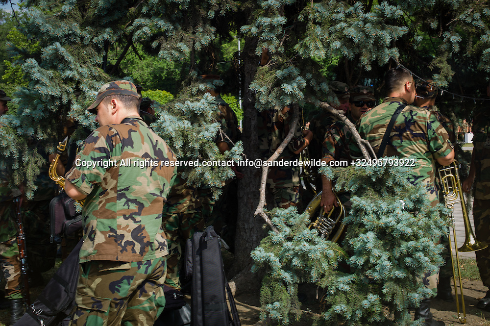 20150824  Moldova Chisinau. Soldiers hide under a tree for the burnig sun with their musical instruments. They exercise  for the Moldovan independance day 27th August.