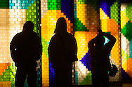 A group looks at a display of colorful blocks located at the base of Taipei 101 in Taipei, Taiwan.