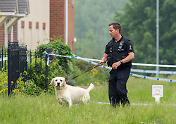 © Licensed to London News Pictures. 28/05/2018. Gloucester, UK. A dog with Police at the scene of a double murder in Dexter Way.  A 31 year old woman and 11 year old girl found dead at a house, and 28 year old man has been arrested on suspicion of murder. Photo credit: Simon Chapman/LNP
