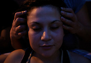 LiLiana Manrique Zavala, of Nayarit, Mexico, gets a massage from co-worker and housemate Andrea Yaneth Virgen, also from Nayarit, Mexico.