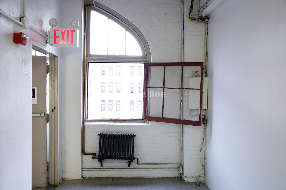 hallway towards exit in an old building