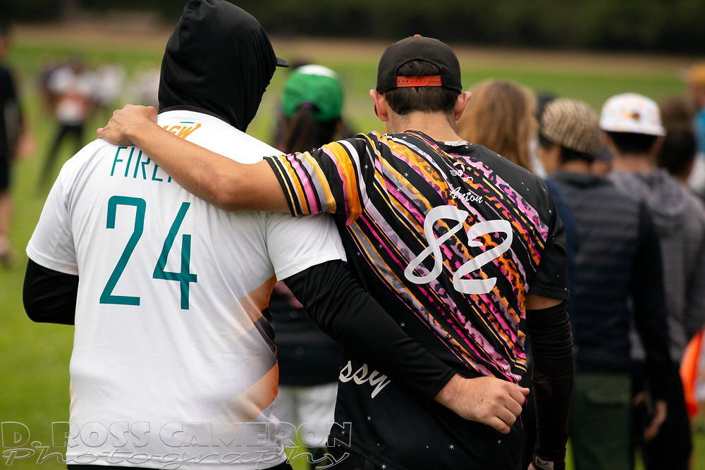 Classy's Joel Anton (82) consoles a player from Firefly during an Ultimate Frisbee tournament game at the Polo Field stadium in Golden Gate Park, on Sunday, July 21, 2019 in San Francisco, Calif. (D. Ross Cameron/SF Chronicle)