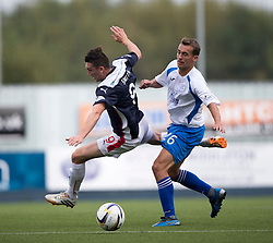 Falkirk's David Smith and Queen of the South's James Fowler.<br /> Half time : Falkirk 0 v 0 Queen of the South, Scottish Championship game played today at The Falkirk Stadium.