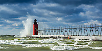 An early winter storm in November send icy waves splashing against the South Haven lighthouse