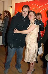 Actor JOHNNY LEE-MILLER artist NATASHA LAW at a private view of artist Natasha Law's work entitled 'Hold' held at Eleven, 11 Eccleston Street, London SW1 on 12th January 2006.<br /><br />NON EXCLUSIVE - WORLD RIGHTS