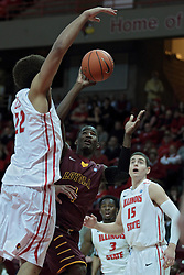 11 January 2014:  Devon Turk goes to the hoop with Reggie Lynch looking for a block during an NCAA  mens basketball game between the Ramblers of Loyola University and the Illinois State Redbirds  in Redbird Arena, Normal IL.  Redbirds win 59-50