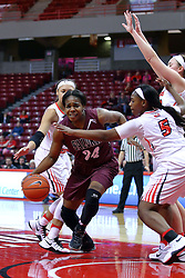 29 January 2017: Kim Nebo dribbles between defenders Katrina Beck and Brechelle Beachum during an College Missouri Valley Conference Women's Basketball game between Illinois State University Redbirds the Salukis of Southern Illinois at Redbird Arena in Normal Illinois.