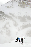 Hikers ascend the Headwall at Jackson Hole Mountain Resort with Corbet's Couloir and Rendezvous Mountain in the distance.