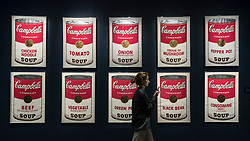 © Licensed to London News Pictures. 01/03/2019. LONDON, UK. A staff member walks by ''Campbell's Soup I'', 1968, by Andy Warhol, (Est. £300,000 - 400,000). Preview of Sotheby's Contemporary Art Sale in their New Bond Street galleries.  Works by artists including Tracey Emin, Jenny Saville, Jean-Michel Basquiat and Andy Warhol will be offered for auction on 5 March 2019.  Photo credit: Stephen Chung/LNP