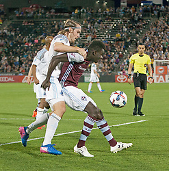 March 18, 2017 - Commerce City, Colorado, U.S - Rapids DOMINIQUE BADJI, center, gets held up from behind as he tries to control the loose ball during the 1st. Half at Dicks Sporting Goods Park Sat. night. The Rapids draw 2-2 to Minnesota United FC. (Credit Image: © Hector Acevedo via ZUMA Wire)