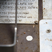 The flap warning marker on the floor of the cockpit of a Dehaviland Beaver on Lake Hood in Anchorage, Alaska.