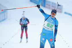 Julia Simon of France celebrates after winning during the IBU World Championships Biathlon Single Mixed Relay competition on February 18, 2021 in Pokljuka, Slovenia. Photo by Vid Ponikvar / Sportida