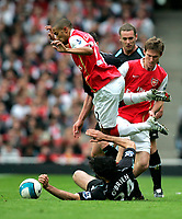Photo: Tom Dulat.<br /> Arsenal v Bolton Wanderers. The FA Barclays Premiership. 20/10/2007.<br /> High fly-Arsenal's Gael Clichy in attempt to get the ball from Joey O'brien of Bolton Wanderers