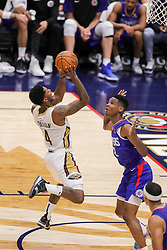 October 23, 2018 - New Orleans, LA, U.S. - NEW ORLEANS, LA - OCTOBER 23:  New Orleans Pelicans guard Elfrid Payton (4) shoots a jump shot against LA Clippers guard Shai Gilgeous-Alexander (2) on October 23, 2018, at Smoothie King Center in New Orleans, LA. (Photo by Stephen Lew/Icon Sportswire) (Credit Image: © Stephen Lew/Icon SMI via ZUMA Press)