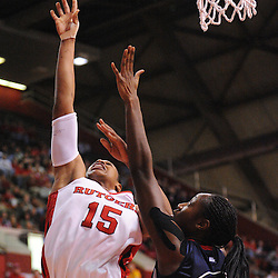 Mar 2, 2009; Piscataway, NJ, USA; Rutgers center Kia Vaughn (15) takes a shot over Connecticut center Tina Charles (31) during the second half of Rutgers game against nationally rated #1 Connecticut at the Louis Brown Athletic Center.  Connecticut won 69-59 to finish their regular season a perfect 30-0.