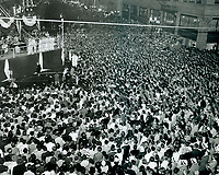 1946 Crowds gather to see KFWB's news flash board at Hollywood Blvd. & Vine St.
