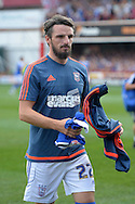 Ex-Brentford player Jonathan Douglas of Ipswich Town arrives pitchside before k/o. Skybet football league Championship match, Brentford v Ipswich Town at Griffin Park in London on Saturday 8th August 2015.<br /> pic by John Patrick Fletcher, Andrew Orchard sports photography.