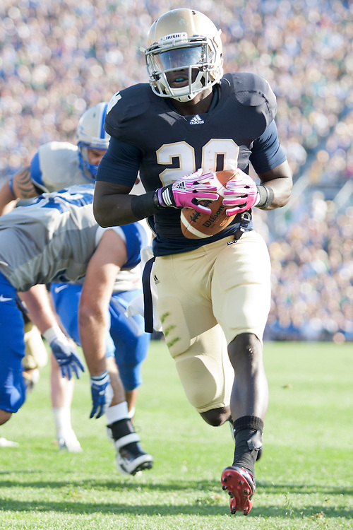 Notre Dame running back Cierre Wood (#20) scores second quarter touchdown during NCAA football game between Notre Dame and Air Force.  The Notre Dame Fighting Irish defeated the Air Force Falcons 59-33 in game at Notre Dame Stadium in South Bend, Indiana.