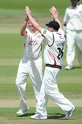 Glen Chapple celebrates with James Falkner as he bowls Ian Cockbain of Gloucestershire for 28 - Photo mandatory by-line: Dougie Allward/JMP - Mobile: 07966 386802 - 08/06/2015 - SPORT - Football - Bristol - County Ground - Gloucestershire Cricket v Lancashire Cricket Day 2 - LV= County Championship