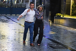 © Licensed to London News Pictures. 30/07/2021.Leeds, UK. Revellers brave storm Evert as they make the most of Friday night out in Leeds. Photo credit: Ioannis Alexopoulos/LNP