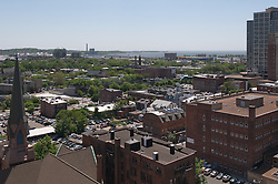 New Haven Skyline view Southeast from Wall Street to the Harbor. Vantage point roof of NH County Courthouse. Trinity Lutheran Church in foreground, 360 State Street Building and Harbor Station in distance.