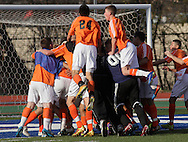 Middletown, New York  - Hicksville High School players celebrate after defeating Webster Schroeder in the New York State Class AA  boys' soccer championship game on Nov. 20, 2011.