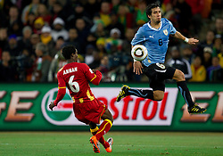 Anthony Annan of Ghana vs Mauricio Victorino of Uruguay  during to the 2010 FIFA World Cup South Africa Quarter Finals football match between Uruguay and Ghana on July 02, 2010 at Soccer City Stadium in Sowetto, suburb of Johannesburg. (Photo by Vid Ponikvar / Sportida)