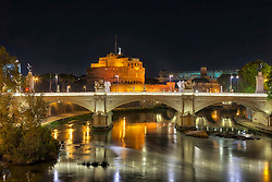 Bridge and Ponte SantAngelo illuminated at night, Rome, Italy