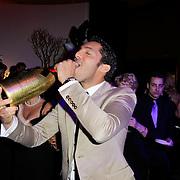 NLD/Amsterdam/20120204 - 30ste Verjaardag Richy Brown, Richy met chanpagnefles