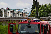Birmingham, United Kingdom, June 14, 2021: Fire Rescue engines are seen outside the Arconic factory site in Birmingham after Palestine Action activists took over the rooftop of an American industrial factory known as Arconic in Birmingham on Monday, June 14, 2021. Some other activists used a sledgehammer to protest against the company who they say 'provided cladding for Grenfell Tower' and 'materials for Israel's fighter jets.' (Photo by Vudi Xhymshiti)