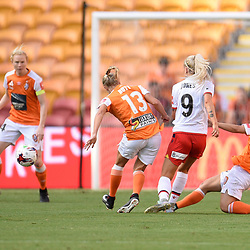 BRISBANE, AUSTRALIA - NOVEMBER 17: Adriana Jones of Adelaide is tackled by Tameka Butt and Katrina Gorry of the Roar during the round 4 Westfield W-League match between the Brisbane Roar and Adelaide United at Suncorp Stadium on November 17, 2017 in Brisbane, Australia. (Photo by Patrick Kearney / Brisbane Roar)