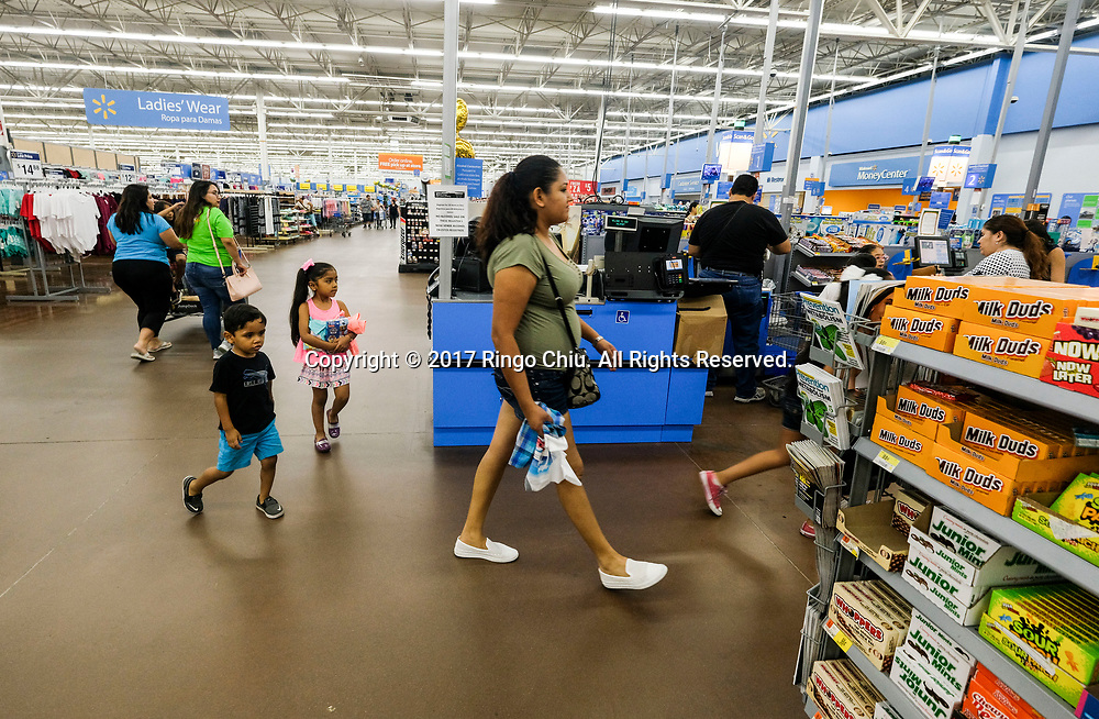 People shop at Walmart in Calexico (the US and Mexico border), California on Wednesday April 19, 2017. (Xinhua/Zhao Hanrong)(Photo by Ringo Chiu/PHOTOFORMULA.com)<br /> <br /> Usage Notes: This content is intended for editorial use only. For other uses, additional clearances may be required.