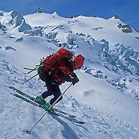 SKIING, Swiss Alps, Jay Jensen (MR) skis Trient Glacier on Haute Route from Chamonix to Zermatt.
