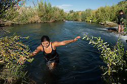 Surita Hernandez brings her children along with neighbors to swim in a river on the Moapa reservation outside Las Vegas, Nevada in July, 2012. They don't get to go outside as often as they like because of the poor air quality. In the photos are: Ayona Hernandez, (wearing glasses)13, Aaliya Hernandez , 16, (grey shirt in ponytail)Gyiel Hernandez, 7, (Small boy)  Surita Hernandez, (mother) 37, Zayda Hernandez, (black shirt) 14,  Edgar Perez, 16, Summer Marie Sunshine Nickrand, 14  and Ayasha Hernandez, 4 and on the Moapa reservation in Nevada. All of their family suffers from Asthma and though they can't prove it, believe its because of the coal plant next door. Her grandfather died in march because of cancer. The Sierra Club is working with the Moapa Band of Paiutes to transition NV Energy away from the Reid Gardner coal-fired power plant -- which sits only 45 miles from Las Vegas and a short walk from community housing at the Moapa River Indian Reservation. The Reid Gardner coal plant is literally spewing out tons of airborne pollutants such as mercury, nitrous oxide, sulfur dioxide, and greenhouse gases. This has resulted in substantial health impacts on the Moapa community, with a majority of tribal members reporting a sinus or respiratory ailment. Vernon Lee believes that the many people on the Moapa reservation suffering from health issues are because of the coal plant next door. Sierra Club is working with the Moapa Band of Paiutes to transition NV Energy away from the Reid Gardner coal-fired power plant -- which sits only 45 miles from Las Vegas and a short walk from community housing at the Moapa River Indian Reservation. The Reid Gardner coal plant is literally spewing out tons of airborne pollutants such as mercury, nitrous oxide, sulfur dioxide, and greenhouse gases. This has resulted in substantial health impacts on the Moapa community, with a majority of tribal members reporting a sinus or respiratory ailment.