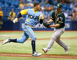 June 10, 2017 - St. Petersburg, Florida, U.S. - WILL VRAGOVIC       Times.Tampa Bay Rays center fielder Mallex Smith (0) dodges a tag from Oakland Athletics starting pitcher Sonny Gray (54) and reaches on his throwing error in the fourth inning of the first game of the double header between the Tampa Bay Rays and the Oakland Athletics at Tropicana Field in St. Petersburg, Fla. on Saturday, June 10, 2017. (Credit Image: © Will Vragovic/Tampa Bay Times via ZUMA Wire)