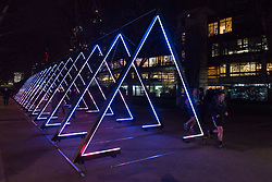 """© Licensed to London News Pictures. 17/01/2018. LONDON, UK.  """"The Wave"""" by Vertigo installed on the South Bank.  Preview of  Lumiere London, the capital's largest arts festival commissioned by The Mayor of London and produced by Artichoke.  Light installations by leading artists have been set up, both north and south of the river.  Photo credit: Stephen Chung/LNP"""