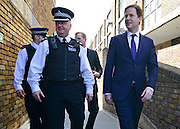 © Licensed to London News Pictures. 25/04/2013. London, UK On the day UK crime are reported at the lowest level for 30 years Deputy Prime Minister Nick Clegg (right) visits Thrayle House, Stockwell Park Estate in Brixton with Jeremy Browne, Minister for Crime Prevention, to meet with police, residents and community workers to see how crime is being tackled in the area, today 25th April 2013.. Photo credit : Stephen Simpson/LNP
