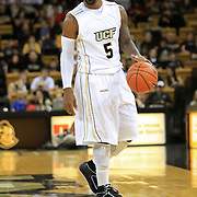 Marcus Jordan (5) of the University of Central Florida Knights mens basketball team dribbles the ball against the West Florida Argonauts in the first home game of the 2010 season at the UCF Arena on November 12, 2010 in Orlando, Florida. UCF won the game 115-61. (AP Photo/Alex Menendez)