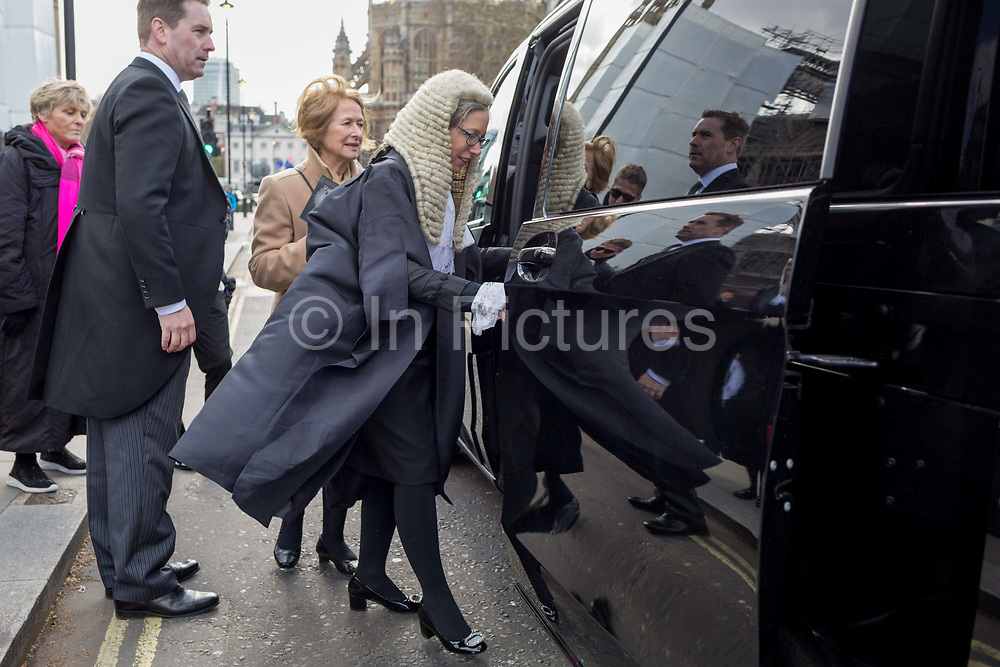 A newly-appointed lady QC Queens Council aka silk in legal vernacular climbs into a London cab after being swoen in to her latest position at the House of Commons, on 11th March 2019, in London, England.