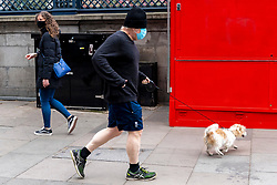 © Licensed to London News Pictures. 10/04/2021. London, UK. British Prime Minister BORIS JOHNSON is seen out exercising in central London with dog DILYN. Photo credit: London News Pictures