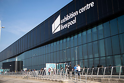 © Licensed to London News Pictures. 06/11/2020. Liverpool, UK. People queue along the side of the Exhibition Centre Liverpool for the noon opening of the walk in Covid testing centre for asymptomatic people as part of mass testing in the city which starts today [06/11/2020]. Photo credit: Kerry Elsworth/LNP