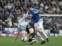 Photo: Lee Earle.<br /> Birmingham City v Chelsea. The Barclays Premiership. 01/04/2006. Chelsea's Joe Cole (L) battles with Damien Johnson.