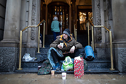 © Licensed to London News Pictures . 25/12/2018 . Manchester , UK . Homeless man MICHAEL BARROW (33 from Northwich) on the steps of the Britannia Hotel on Portland Street . The Hull Royal Hotel - a branch of the Britannia chain - was criticised after cancelling a paid booking by homeless charity Raise the Roof Homeless Project , which planned on giving homeless people a room for Christmas . Homeless people sleeping rough on the streets of Manchester City Centre on Christmas Day . Photo credit : Joel Goodman/LNP
