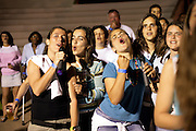 Girls from different teams singing in a karaoke party held at the end of the Loule Tournement.