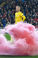 Football - 2018 / 2019 UEFA Nations League B - Group Four: Wales vs. Denmark<br /> <br /> Kasper Schmeichel of Denmark behind red smoke from a flare thrown on to the pitch , at Cardiff City Stadium.<br /> <br /> COLORSPORT/WINSTON BYNORTH