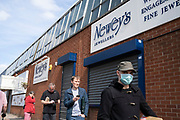 Local atmosphere due to Coronavirus lockdown is felt on a street by street level as streets remain deserted apart from people queueing for shops in the Jewellery Quarter as people observe the stay at home advice from the government on 7th April 2020 in Birmingham, England, United Kingdom. Coronavirus or Covid-19 is a new respiratory illness that has not previously been seen in humans. While much or Europe has been placed into lockdown, the UK government has announced more stringent rules as part of their long term strategy, and in particular social distancing.