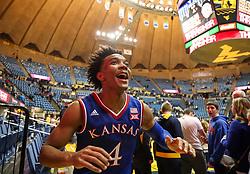Jan 15, 2018; Morgantown, WV, USA; Kansas Jayhawks guard Devonte' Graham (4) celebrates after beating the West Virginia Mountaineers at WVU Coliseum. Mandatory Credit: Ben Queen-USA TODAY Sports
