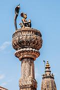 Statue on top of King Yoganarendra Malla's column, Durbar Square, Patan, Nepal