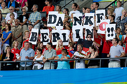 "Fans with a poster ""Thank you Berlin(o)"" during day nine of the 12th IAAF World Athletics Championships at the Olympic Stadium on August 23, 2009 in Berlin, Germany. (Photo by Vid Ponikvar / Sportida)"